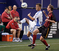 The Wizard's Jack Jewsbury keeps a ball inbounds as the MetroStars' Eddie Gaven watches. The Kansas City Wizards were defeated by  the NY/NJ MetroStars to a 1 to 0 at Giant's Stadium, East Rutherford, NJ, on May 30, 2004.