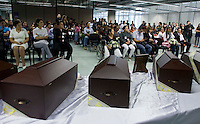 People attend a ceremony in honor of the nine skeletal presented to their families by The Attorney General's Office in Medellin,. The exhumations Were Conducted in the Departments of Antioquia, Risaralda and Meta., Colombia, 20/04/2012. Photo by Fredy Amariles / viewpress.