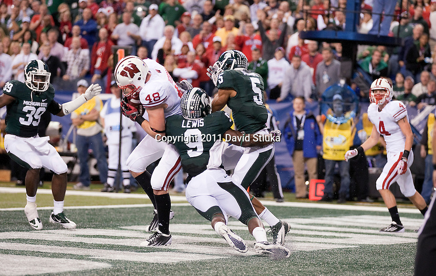 Wisconsin Badgers tight end Jacob Pedersen (48) catches a 2-point conversion pass from quarterback Russell Wilson (16) during the NCAA Big Ten Conference Championship college football game against the Michigan State Spartans on December 3 , 2011 in Indianapolis, Indiana. The Badgers won 42-39. (Photo by David Stluka)