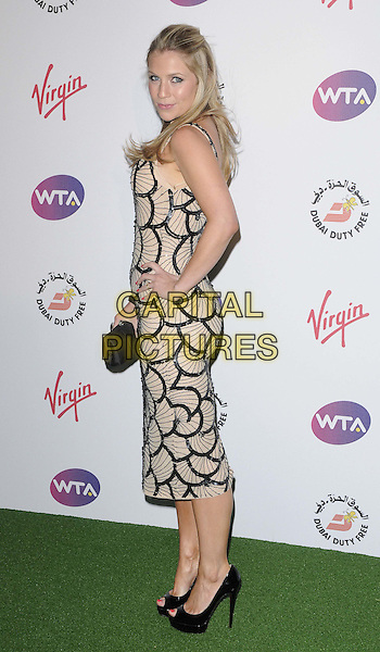 Millie Clode.The WTA Pre-Wimbledon Party, The Roof Gardens, Kensington High St., London, England..June 21st, 2012.full length beige black pattern print dress hand on hip side clutch bag.CAP/CAN.©Can Nguyen/Capital Pictures.