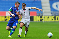Joe Gelhardt of Wigan Athletic vies for possession with Jake Bidwell of Swansea City during the Sky Bet Championship match between Wigan Athletic and Swansea City at The DW Stadium in Wigan, England, UK. Saturday 2 November 2019