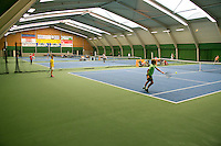 20131201,Netherlands, Almere,  National Tennis Center, Tennis, Winter Youth Circuit, warming up<br /> Photo: Henk Koster