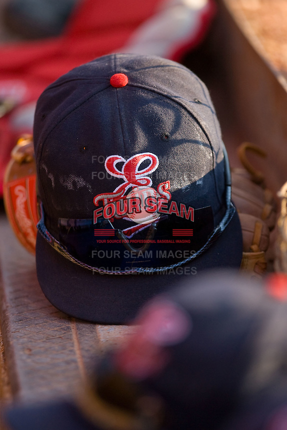 An Elizabethton Twins hat sits on the top step of the visitors dugout at Howard Johnson Field July 3, 2010, in Johnson City, Tennessee.  Photo by Brian Westerholt / Four Seam Images