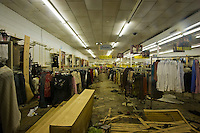 Ghostly in the middle of the night, Rainbow Apparel remains completely untouched a year later after Hurricane Katrina in New Orleans, Louisiana. The lights have been on 24 hours a day since the power was turned on to the city and clothes still remain on the racks at Rainbow Apparel where there was once at least 3 feet of water.