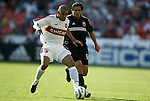 24 April 2004: C.J. Brown (left) steps in front of Jamie Moreno (right) and takes the ball away during the first half. The Chicago Fire defeated DC United 1-0 at RFK Stadium in Washington, DC on opening day of the regular season in a Major League Soccer game..