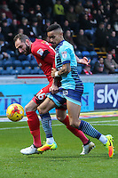 Nicky Hunt of Leyton Orient (16) and Paris Cowan-Hall of Wycombe Wanderers during the Sky Bet League 2 match between Wycombe Wanderers and Leyton Orient at Adams Park, High Wycombe, England on 17 December 2016. Photo by David Horn / PRiME Media Images.