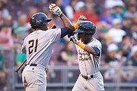 Vidal Brujan (2) of the Bowling Green Hot Rods celebrates with teammate Moises Gomez (21) after hitting a home run against the Dayton Dragons at Fifth Third Field on June 8, 2018 in Dayton, Ohio. The Hot Rods defeated the Dragons 11-4.  (Brian Westerholt/Four Seam Images)