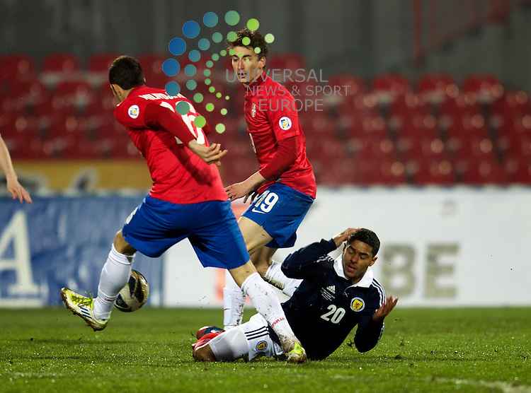 Liam Bridcutt of Scotland challenges for the ball against Luka Milivojevic during the Fifa World Cup Qualifier between Serbia and Scotland at Stadion Karadorde, Novi Sad, Serbia. 26 March 2013. Picture by Ian Sneddon / Universal News and Sport (Scotland). All pictures must be credited to www.universalnewsandsport.com. (Office) 0844 884 51 22. .