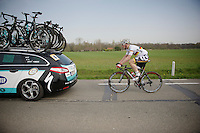 André Greipel (DEU/Lotto-Belisol) trailing behind the OPQS-teamcar while returning to the peloton after he changed bikes<br /> <br /> Gent-Wevelgem 2014