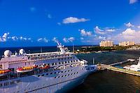 Carnival Fantasy cruise shipw with the Atlantis Paradise Island resort in background, Nassau, The Bahamas