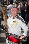 © Joel Goodman - 07973 332324 . 22/06/2014 .  Manchester , UK . WILLIAM HERETY (87) who carried the 2012 Olympic Torch in the Bolton to Liverpool leg of the relay . The 2014 Manchester Day Parade . Photo credit : Joel Goodman
