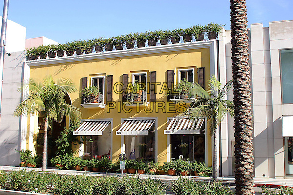 BIJAN SHOP.Famous Beverly Hills Landmarks. Beverly Hills, California..January 5th, 2005.Photo Credit: Jacqui Wong/Admedia.store, building, potted plants yellow balcony.www.capitalpictures.com.sales@capitalpictures.com.© Capital Pictures.