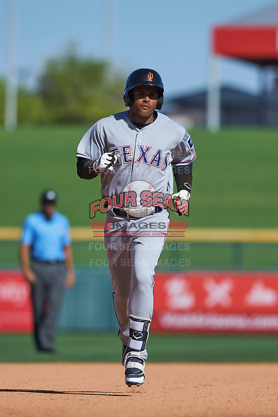 Surprise Saguaros second baseman Luis La O (9), of the Texas Rangers organization, rounds the bases after hitting a home run during an Arizona Fall League game against the Mesa Solar Sox on October 20, 2017 at Sloan Park in Mesa, Arizona. The Solar Sox walked-off the Saguaros 7-6.  (Zachary Lucy/Four Seam Images)