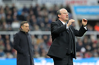Newcastle manager Rafa Benitez (R) gives his players instruction during the Premier League match between Newcastle United and Swansea City at St James' Park, Newcastle, England, UK. Saturday 13 January 2018