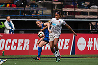 Seattle, WA - Sunday, August 13, 2017: Kristen McNabb and Jessica McDonald during a regular season National Women's Soccer League (NWSL) match between the Seattle Reign FC and the North Carolina Courage at Memorial Stadium.