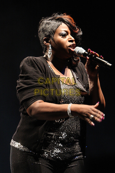ANGIE STONE.Performing live at the Hammersmith Apollo, London, England..March 5th, 2010.stage concert gig performance music half length black jacket top singing profile.CAP/MAR.© Martin Harris/Capital Pictures.