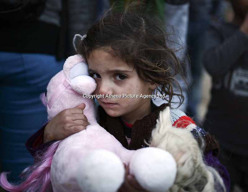 Pictured: A girl clutches her soft toy Monday 07 March 2016<br /> Re: Migrants have been gathering at the port of Piraeus, near Athens, Greece.