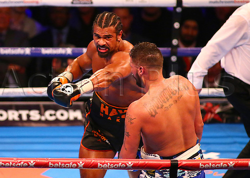 March 4th 2017, O2 Arena, London England; Heavyweight Boxing David Haye versus Tony Bellew; David Haye forces Tony Bellew towards the ropes, and catches him with a left swing, during the Heavyweight contest