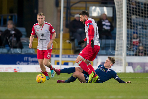30th November 2019; Dens Park, Dundee, Scotland; Scottish Championship Football, Dundee Football Club versus Queen of the South; Stephen Dobbie of Queen of the South is tackled by Finlay Robertson of Dundee  - Editorial Use