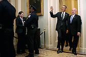 United States President Barack Obama is accompanied by Sergeant at Arms of the U.S. Senate Terrance Gainer as he arrives for a meeting with members of the Senate Democratic Caucus in the Mansfield Room at the U.S. Capitol March 12, 2013 in Washington, DC. With tax reform, spending cuts, gun control and immigration on the agenda, Obama will be holding four meetings over three days this week with Republican and Democratic members of Congress at the U.S. Capitol. .Credit: Chip Somodevilla / Pool via CNP