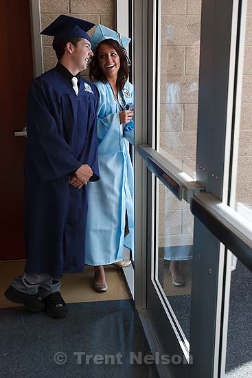 Salem - Before the Processional at Salem Hills High School's first ever graduation ceremony Wednesday May 27, 2009, graduating seniors Mike Brimley (left) and Kalie Bird share a laugh.