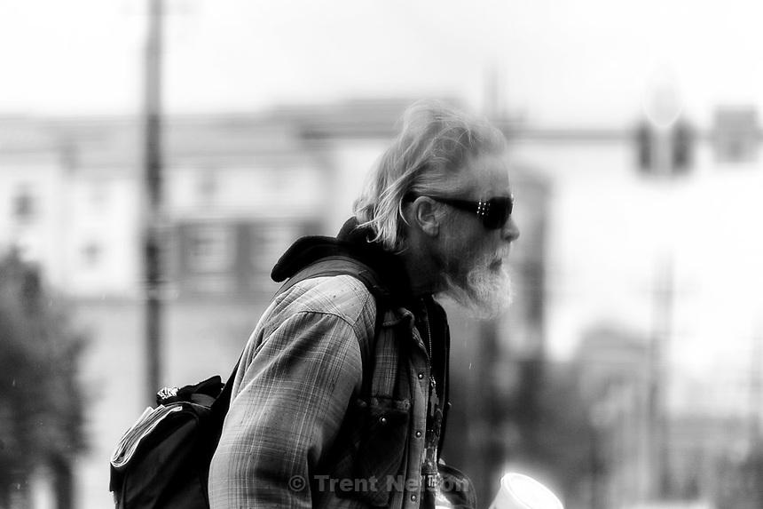 man crossing street, Tuesday May 26, 2015.