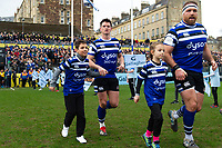 Freddie Burns of Bath Rugby mascot in hand runs out onto the field. Gallagher Premiership match, between Bath Rugby and Harlequins on March 2, 2019 at the Recreation Ground in Bath, England. Photo by: Patrick Khachfe / Onside Images