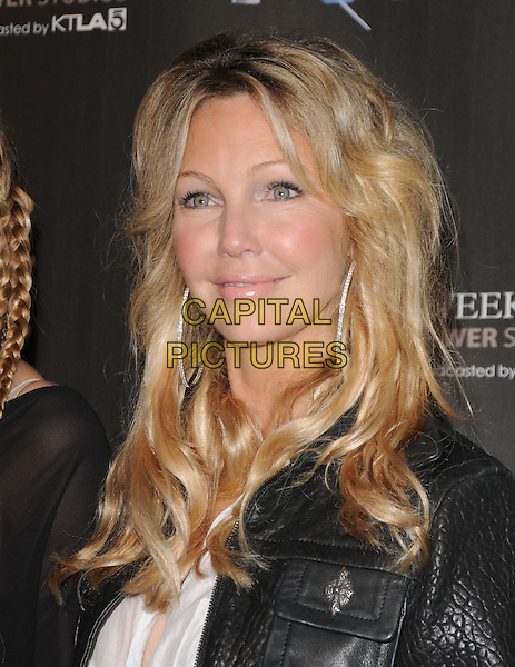 HEATHER LOCKLEAR .The WTB Spring 2011 Fashion Show Presented by Richie Sambora & Nikki Lund held at Sunset Gower Studios in Hollywood, California, USA..October 17th, 2010.White Trash Beautiful headshot portrait black leather silver hoop earrings .CAP/RKE/DVS.©DVS/RockinExposures/Capital Pictures.