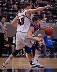OMAHA, NE - Cody Larson #34 of South Dakota State attempts to break through the defense of Matt Hagerbaumer #42 of the University of Nebraska at Omaha during their game Thursday evening at Ralston Arena in Omaha, NE. (Photo By Ty Carlson/DakotaPress.org)