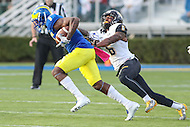 Newark, DE - October 29, 2016: Delaware Fightin Blue Hens wide receiver Jamie Jarmon (6) avoids the tackle by Towson Tigers defensive back Troy Jeter (6) during game between Towson and Delware at  Delaware Stadium in Newark, DE.  (Photo by Elliott Brown/Media Images International)