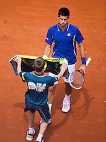 03-06-13, Tennis, France, Paris, Roland Garros,  Novak Djokovic gets a towel from a ballboy