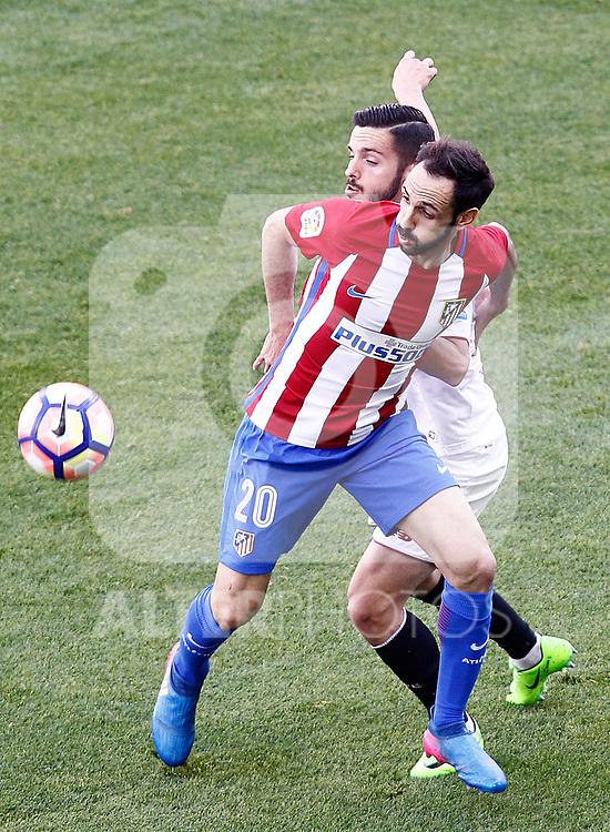 Atletico de Madrid's Juanfran Torres (l) and Sevilla FC's Pablo Sarabia during La Liga match. March 19,2017. (ALTERPHOTOS/Acero)