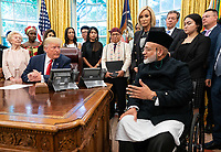 United States President Donald J. Trump meets with survivors of religious persecution in the Oval Office at the White House in Washington, D.C. on Wednesday, July 17, 2019. Photo Credit: Kevin Dietsch/CNP/AdMedia