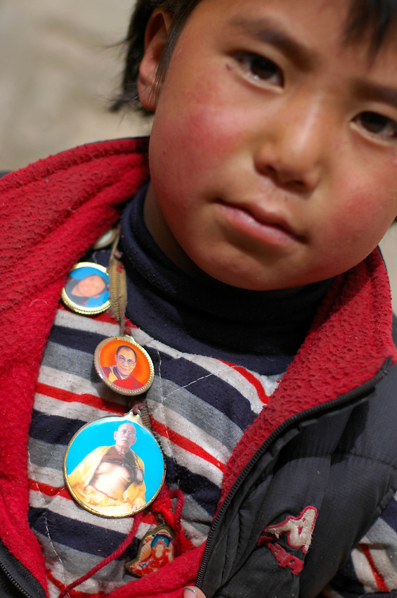 Tibetan boy with necklace of high Buddhist lamas - March 21, 2008 - Michael Benanav - 505-579-4046