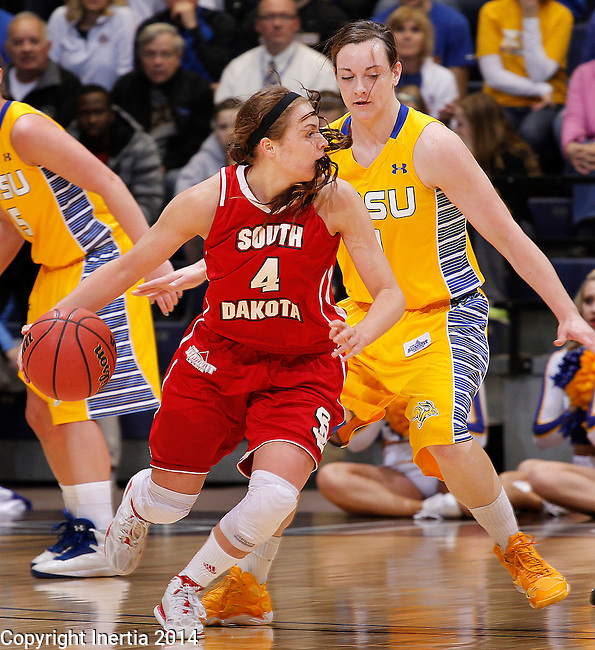 SIOUX FALLS, SD - MARCH 10:  Tia Hemiller #4 of South Dakota dribbles toward Gabby Boever #4 of South Dakota State during their semifinal game at the 2014 Summit League Basketball Championships at the Sioux Falls Arena Monday.  (Photo by Dick Carlson/Inertia)