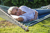 USA, California, Big Sur, Esalen, woman takes a rest on a hammock by the Farm House in the afternoon, the Esalen Institute