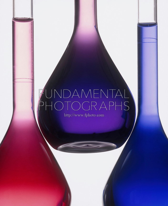 COBALT CHLORIDE: TEMPERATURE EQUILIBRIUM IN HCl<br /> Both Pink & Blue Ions Are Present As Violet Color<br /> At room temp solution of Co(H2O)6(aq) + 4Cl(aq) = CoCl4(aq) + 6H2O shows both pink Co(H2O)6 and blue CoCl4 ions present as violet color. Heating solution shifts equilibrium to form more blue ions and cooling it causes the pink ions to increase.