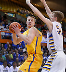 RAPID CITY, SD - MARCH 18, 2017 -- Cole Bergan #40 of Aberdeen Central spins on JP Costello #50 of Sioux Falls O'Gorman during the 2017 South Dakota State Class AA Boys Basketball Championship game Saturday at Barnett Arena in Rapid City, S.D.  (Photo by Dick Carlson/Inertia)