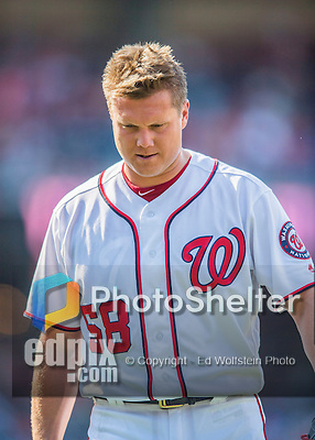 24 July 2016: Washington Nationals pitcher Jonathan Papelbon returns to the dugout after giving up 4 runs in the top of the 9th inning to the San Diego Padres at Nationals Park in Washington, DC. The Padres defeated the Nationals 10-6 to take the rubber match of their 3-game, weekend series. Mandatory Credit: Ed Wolfstein Photo *** RAW (NEF) Image File Available ***