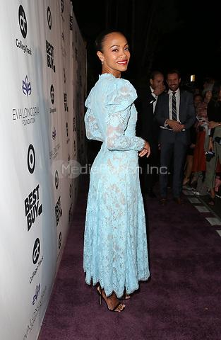 LOS ANGELES, CA - NOVEMBER 8: Zoe Saldana, at the Eva Longoria Foundation Dinner Gala honoring Zoe Saldana and Gina Rodriguez at The Four Seasons Beverly Hills in Los Angeles, California on November 8, 2018. Credit: Faye Sadou/MediaPunch