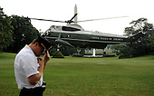 A Secret Service agent holds onto his hat as Marine One, with United States President Barack Obama aboard, departs the South Lawn of the White House en route to Martha's Vineyard for a ten day vacation on Thursday, August 18, 2011 in Washington..Credit: Roger L. Wollenberg / Pool via CNP