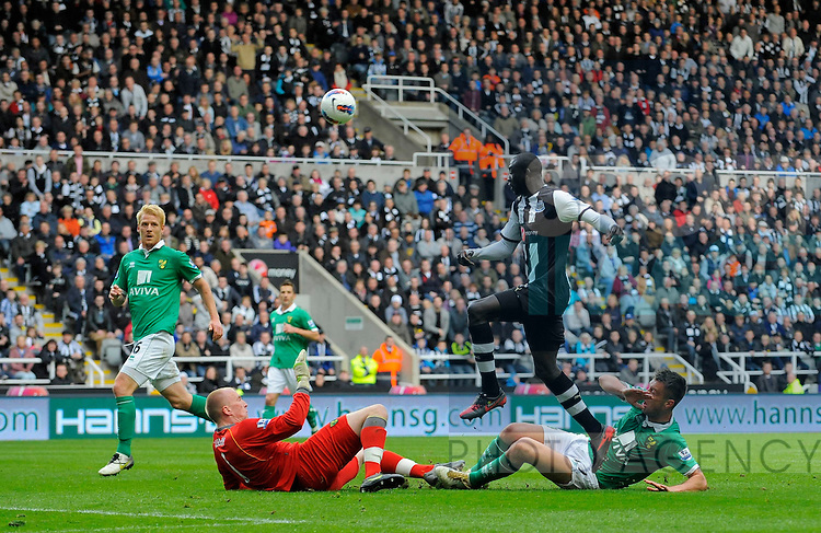 Papiss Cisse of Newcastle United (2nd R) sees his effort saved by keeper John Ruddy of Norwich City (2nd L).Barclays Premier League match between Newcastle United and Norwich City at the Sports Direct Arena at Newcastle 18th March 2012..©Sportimage +44 7980 659747.picturedesk@sportimage.co.uk.http://www.sportimage.co.uk/.Editorial use only. Maximum 45 images during a match. No video emulation or promotion as 'live'. No use in games, competitions, merchandise, betting or single club/player services. No use with unofficial audio, video, data, fixtures or club/league logos.