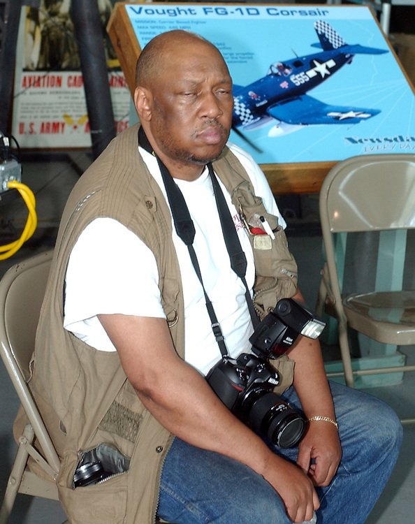 Daily News Photographer, Willie Anderson at Republic Airport Farmingdale to witness the arrival of a B-29 Bomber at the American Airpower Museum on Monday June 7, 2004. (Photo / Jim Peppler).