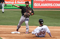 Quad Cities River Bandits second baseman Alex Hernandez (6) turns a double play as Scooter Gennett (20) slides in during a game against the Wisconsin Timber Rattlers on May 2nd, 2015 at Fox Cities Stadium in Appleton, Wisconsin.  Quad Cities defeated Wisconsin 5-2.  (Brad Krause/Four Seam Images)