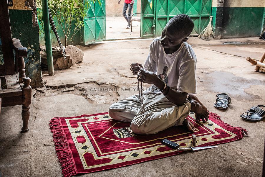 CAR, Bangui: a member of the auto-defense just finish his prayer in the headquarter of the auto-defense PK5. 14th April 2016<br /> <br /> RCA, Bangui : un membre de l'auto-d&eacute;fense du PK5 vient de terminer sa pri&egrave;re. 14 avril 2016