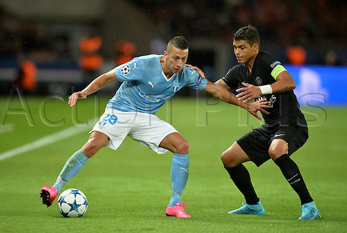15.09.2015. Paris, France. UEFA Champions League football. Paris St Germain versus Malmo.  Nikola Djurdjic (mal) holds off Thiago Silva (psg)