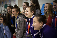 NWA Democrat-Gazette/CHARLIE KAIJO Fayetteville's Audrey McKinnon (center) poses for pictures with her relay team during a swim meet, Saturday, February 9, 2019 at the University of Arkansas HYPER pool in Fayetteville.