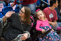 NWA Democrat-Gazette/BEN GOFF @NWABENGOFF<br /> Maggie Alexander, 4, and mother Kelly Alexander of Rogers smile Thursday, Feb. 8, 2018, during an event to surprise Maggie with her wish from Make-A-Wish Mid-South at Rogers High. The Rogers High DECA Club and Make-A-Wish Mid-South surprised Maggie, who has been diagnosed with spinal muscular atrophy type II, with a seven-day trip to Disney World. Maggie and her family will leave for their trip in two weeks.