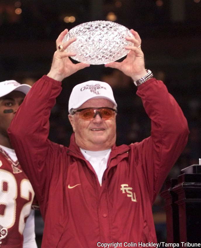 NEW ORLEANS, LA 1/4/00-Florida State Coach Bobby Bowden hoists the glass football portion of the Sears Trophy over his head after FSU won their second national Championship by defeating Virginia Tech in the Sugar Bowl. COLIN HACKLEY PHOTO