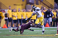Isi Sofele of California tries to avoid being tackled during a game against Arizona State at Sun Devil Stadium in Tempe, California on November 25th, 2011  - California defeated Arizona State  47 - 38